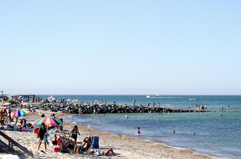 Crowds Flock To Inkwell Beach Including Early Morning Polar Bear Club