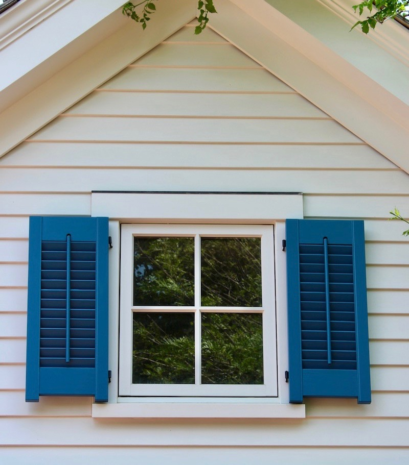 Colors of shutters brick exterior with black shutters for Should plantation shutters match trim