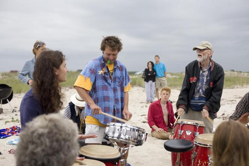 Drummers play on the beach