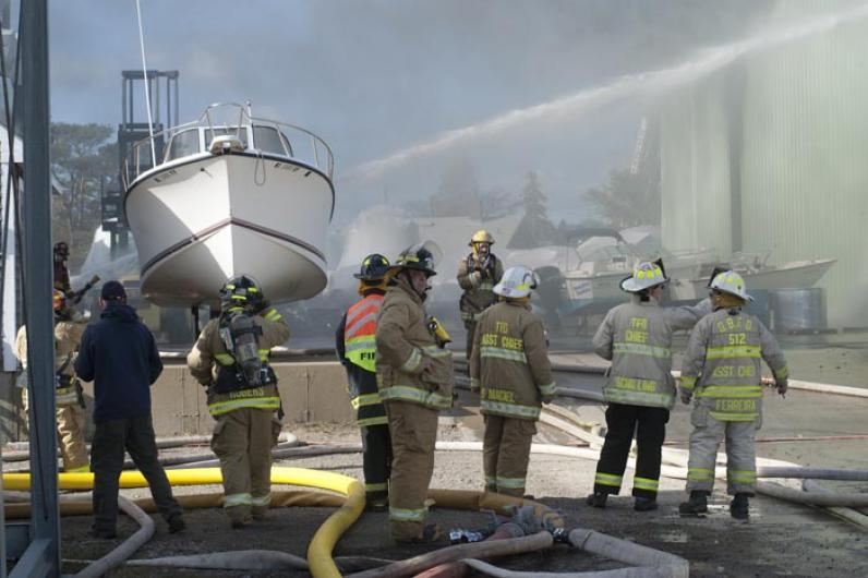 Fire Maciel Marine boat shed firemen