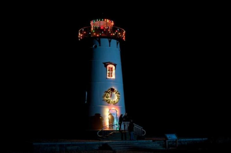 a wreath hung on the lighthouse with care thanks to the christmas decorations committee