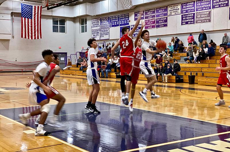 Boys basketball team at play