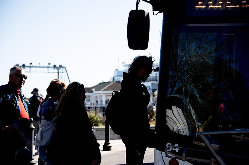 Passengers board a bus at the Steamship Authority terminal in Vineyard Haven.