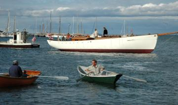 rowing to the sailboat