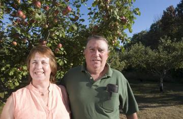 Debbie and Eric Magnuson in orchard