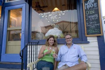 Virginia Alfaro and Capt. Bob Balewicz in front of Cafe Moxie