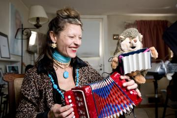 bella playing accordian