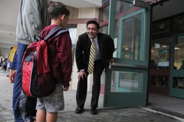 principal richie smith greets students