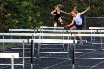 Julia Reagan Rose Engler jumping hurdles