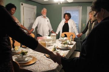 Abigail West Tony dinner table dining room praying