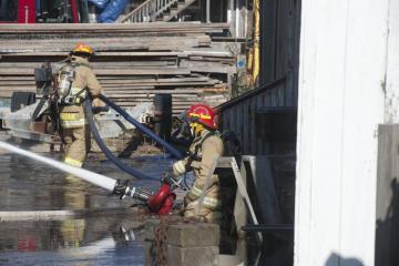 Fire Maciel Marine boat shed fire fighters hose