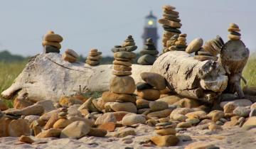 stone beach cairns lighthouse