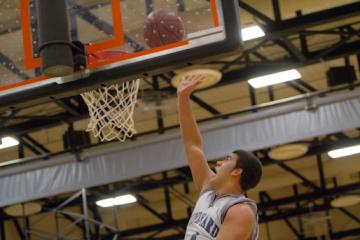 Senior Del Araujo tips it into the basket during a semifinal match Wednesday against Westwood.