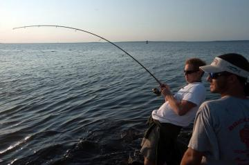 Chris Reimann and Joe Rogers fish at sunset