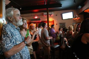 Christine Todd watches The Vineyard at a bar
