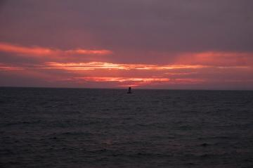 Sun sets in the west over the Menemsha buoy.