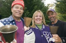 fans with cowbells