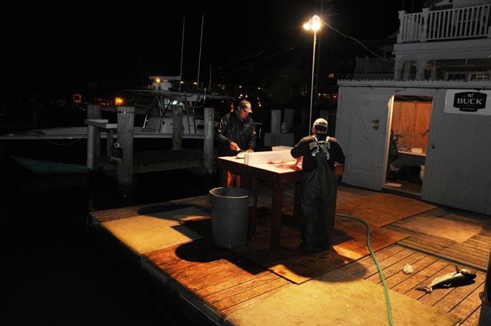 dock fishermen night time filleting station