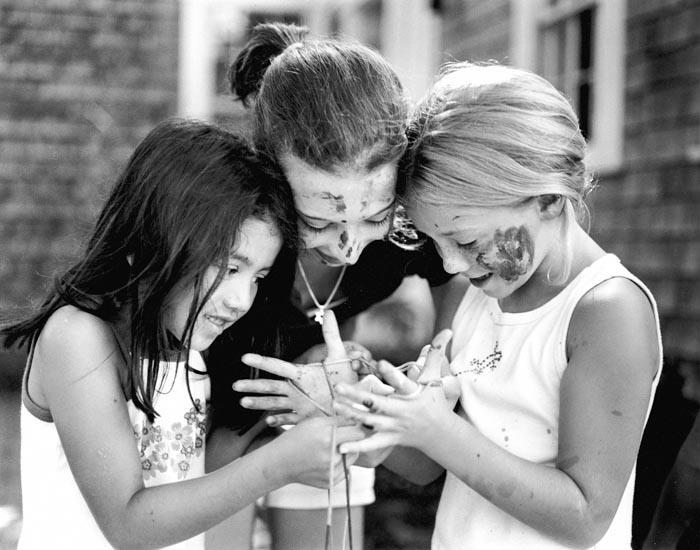 three girls, playing