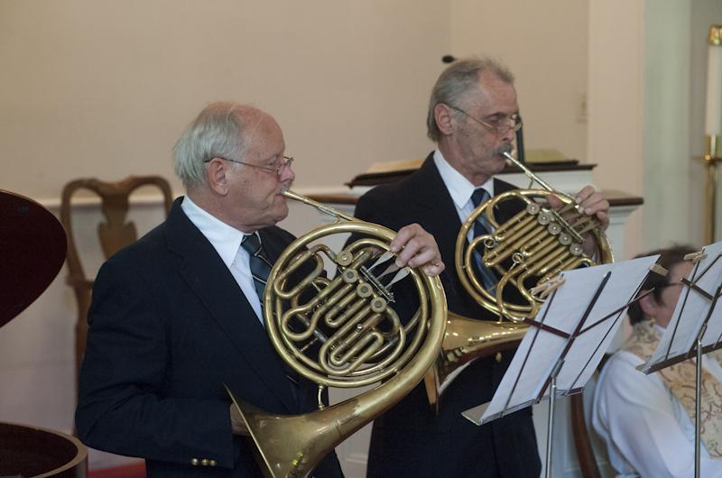 Frank and Peter Dunkl play French horn part of the musical prelude.