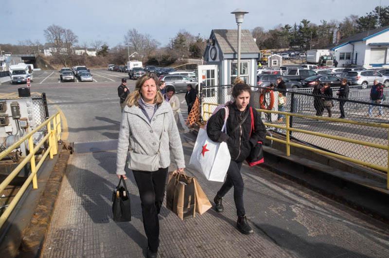 Passengers board the fast ferry Seastreak.