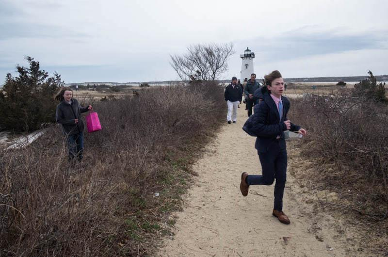 Older hunters go searching for eggs near the Edgartown Lighthouse.